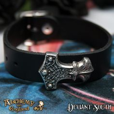 "Alchemy Gothic A120 Wenig Thunderhammer leather wriststrap  A small, antiqued pewter copy of the Hammer of Thor, riveted to a ¾"" wide black leather wrist strap, with buckle for adjustment."