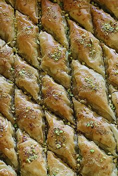 A while back I saw a video showing a very skilled Turkish baklava maker making, of course, a huge tray of baklava.unrolling the phyllo d. Lebanese Recipes, Turkish Recipes, Greek Recipes, Desert Recipes, Pistachio Baklava, Middle Eastern Desserts, Eastern Cuisine, Sweet Pastries, Pasta
