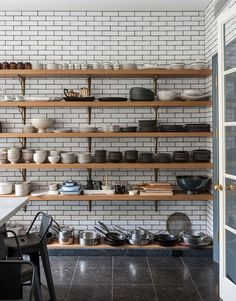 This open shelving against the subway tiles looks striking, but the dust everything would collect does not entice me!