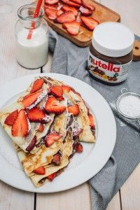 Crepes with strawberries and Nutella hazelnut spread