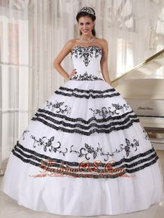Impression White and Black Quinceanera Dress Sweetheart Floor-length Tulle Embroidery Ball Gown  http://www.fashionos.com    This white and black quinceanera dress will make you attract the most eyes.The fitted,strapless bodice is accented with a sweetheart neckline and exquisite appliques.The bouffant skirt in constrasting colors that decorated by the floral embellishment gives you a dramatic feeling.A lace up back completes this fabulous design.
