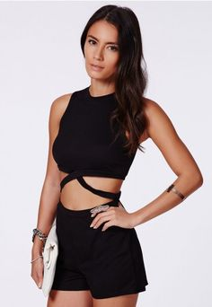 A #Missguided fave - the #black #bandagewaist is now available in #playsuit form with this cheeky cut out piece. Featuring high neck detailing too, this key style is great for any season. Team with bold contrasting accessories for a striking look.