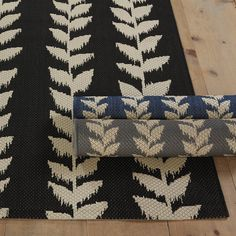 Bring the outside in and the inside out with our Ainsley Indoor/Outdoor Rug. Designed for busy family spaces where spills and pets are part of everyday life, the this kitchen rug is easy to clean with soap and water from the hose. This porch rug will add style to any space, from an entryway rug to the laundry room, performance rugs from Ballard Designs have it all.   #PerformanceRug #StainProof #KidProofRug #DogProofRug
