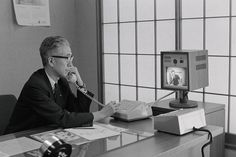 This Japanese Executive communicates with one of his subordinates via a new video telephone in his office. The multi channel videophone was invented and installed by the Nippon Electric Company and cost $1,300 U.S. dollars for a one-channel set up in 1967