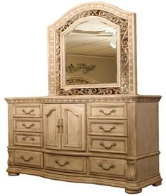 The Cordoba Blanco is crafted of pine solids and veneers with an arched top and scrolling iron inset in an antique white finish.  It features a beveled mirror.
