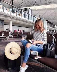 striped tee + distressed denim + sneakers + hat.