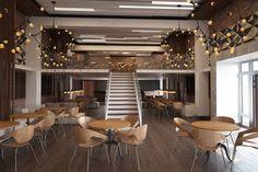 Дизайн интерьера ресторана выполнен в современном стиле лофт.