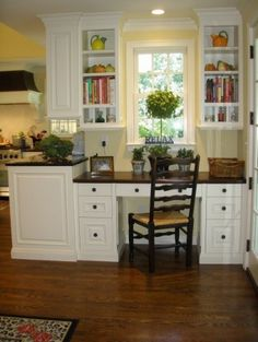 add a built in desk in your kitchen for an instant home office area.  LOVE everything about this.  So homey!