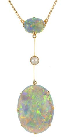An early 20th century gold opal and split pearl necklace. The oval opal cabochon, suspended from a split pearl knife-edge bar, to the oval opal surmount and trace-link chain. Length 40.5cms. Total weight 8gms.