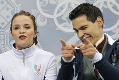 Anna Cappellini and Luca Lanotte of Italy gestures as they wait in the results area after competing in the ice dance free dance figure skati...