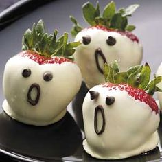 Strawberry Ghosts:  Kids will gasp in delight at these adorable ghosts.  Juicy strawberries, chocolate, and a lick of almond flavor make these little bites a howling success!