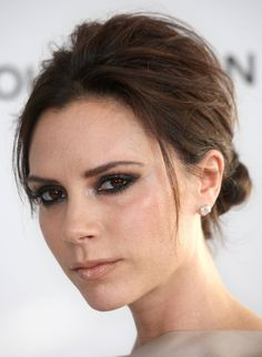 """Victoria Beckham, wearing a """"prom up-do"""" but it's perfect for a holiday party and I'm loving the volume in the crown, and the low, elegance in the back!"""