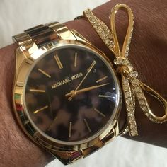 Michael Kors Tortoise Watch Michael Kors slim runway tortoise and gold tone watch. Shiny gold tone stainless steel. Round case. Tortoise dial. Analog movement. Approx. 42mm case and 20mm lug width. 3 hand watch. Michael Kors Accessories Watches