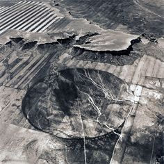 """Emmet Gowin, from """"Changing the Earth."""" The Buffalo Jump called Chugwater and an Irrigation Pivot near Wheatland, Wyoming, 1991"""