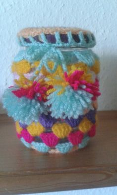 Crotchetted cover for mason jar with little pom poms