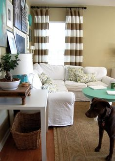 family room inspiration. light furniture covers. neutral walls. colored coffee table. wicker basket
