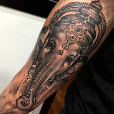 Black and grey style tattoo of Ganesha on hte right forearm.Done by Sergio Fernández Hindu Tattoos, God Tattoos, Skull Tattoos, Body Art Tattoos, Tattoos For Guys, Sleeve Tattoos, Tatoos, Tatto Ganesha, Ganesha Tattoo Sleeve