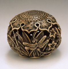 Insects amid Autumn Flowers and Grasses netsuke, mid to late 19th century Japan. Ivory with staining, sumi; ryūsa type
