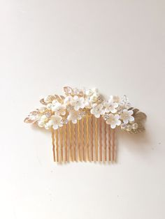 A personal favorite from my Etsy shop https://www.etsy.com/listing/236154345/delicate-bridal-hair-comb-fascinator