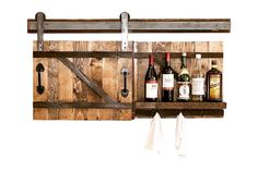 Store your favorite bottles of wine in this beautiful, rustic Wine bar with a sliding barn door. Place it in your den, bar area, kitchen, and even living room area to add some interest! Purchase it on our website, www.grainandforge.com!  #WineBar #Rustic #BarnDoor #WineBottles #WineStorage #DenDecor #KitchenDecor #LivingSpaceDecor #UniqueDecor #UrbanDecor #RusticDecor #GiftForHer #VDayGift