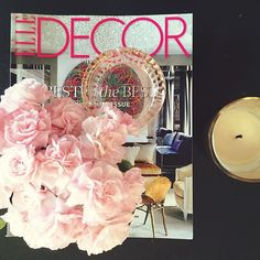 coffee table vignette. accesories. pink flowers. magazines. candles #splendorstyling