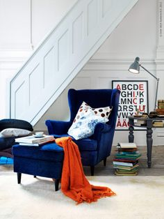 Oh how about a blue velvet COMFY chair? i love dark blue and orange , plus its blue velvet haha