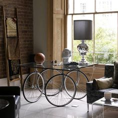 Bicycle wheels as table legs...what will they think of next?!?