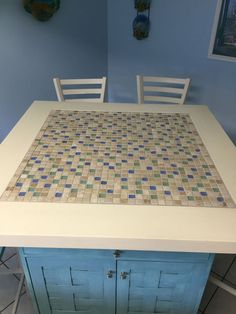 Built-up cabinet with tiled top.  How fun would it be top it with a Scrabble board?