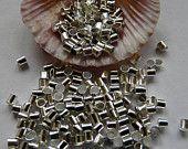 500 silver plated crimp tube beads 1.5mm. €1.50, via Etsy.