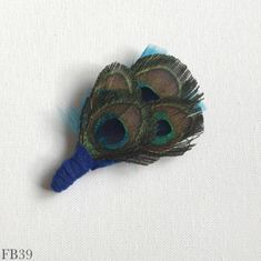 Feather brooches handmade with a selection of feathers and other dyed feathers - super versatile to customize headpieces, fedoras & coats - Tipperary Feather Hat, Brooches Handmade, Peacock Feathers, Organza Gift Bags, Hat Pins, Peacocks, Brooch Pin, Headpiece, Faux Fur