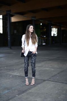Shop this look on Lookastic:  http://lookastic.com/women/looks/white-dress-shirt-black-crossbody-bag-black-and-white-skinny-jeans-black-heeled-sandals/2752  — White Dress Shirt  — Black Leather Crossbody Bag  — Black and White Print Skinny Jeans  — Black Leather Heeled Sandals