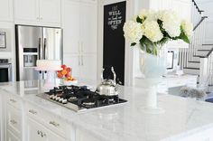 SMP Living The Doctor's Closet 6 Shaker Style Cabinets, White Cabinets, Kitchen Chalkboard, Framed Chalkboard, Marble Countertops, Kitchen Interior, Kitchen Design, Kitchen Ideas, Island Cooktop