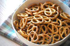 Taste of Home Ranch Pretzels Recipe  Ingredients 1 package (20 ounces) pretzels 1 envelope ranch salad dressing mix 3/4 cup canola oil 1-1/2 teaspoons dill weed 1-1/2 teaspoons garlic powder  Directions Break pretzels into bite-size pieces (if necessary) and place in a large bowl. Combine remaining ingredients; pour over pretzels. Stir to coat. Pour into an ungreased 15-in. x 10-in. x 1-in. baking pan. Bake at 200° for 1 hour, stirring every 15 minutes.