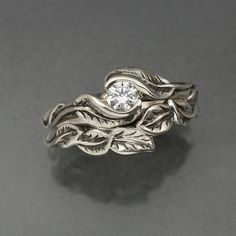 Unique leaf wedding band and engagement ring set. Silver leaves.  Looks elvish!  Made by Bandscapes, on etsy.