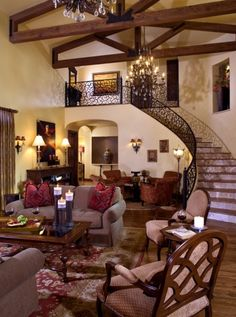 Tuscany style living room.  Wrought iron along the staircase, and wooden beams.  This is typical elements of Tuscany style design.