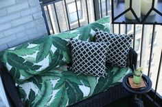 REVEAL // Viceroy Inspired Balcony Outdoor lanterns, outdoor love seats, green black and white stripe bamboo pattern outdoor throw pillows, outdoor ottoman, banana palm leaf print outdoor fabric, vintage brass pitcher, vintage cocktail glasses, HGTV Star, DIY, aloe plants, astro turf, high-rise pre-war, apartment building patio balcony terrace, outdoor entertaining, orange gold polka dot cocktail napkin, vintage equestrian ashtray