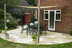 This look was created using Saxon Swirl and Fossil Cream sandstone paving