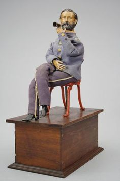 *GENERAL GRANT SMOKING TOY ~ Ives, Blakeslee Company Bridgeport, Connecticut-Clockwork toys come no finer than this one. The original cost of $6.00 in 1880 was a significan sum of money. This toy has the capability of drawing in smoke from a lit tiny cigar + then exhaling it.