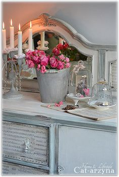 I love the pop of pink from the flowers, with the pale grey-blue background.