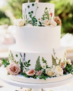 This simply frosted wedding cake was accented with a layered combination of floral! Delicate pressed flowers, applied to the cake, created… Summer Wedding Cakes, Elegant Wedding Cakes, Wedding Cake Designs, Wedding Desserts, Wedding Cake Edible Flowers, Cake Flowers, Herb Wedding, Wedding Ideas, Painted Wedding Cake