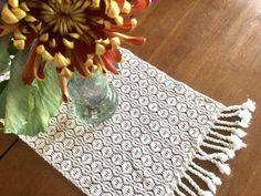 Woven in mahogany and natural cotton this table topper adds a fall touch to my table. Farmhouse Table Runners, Modern Farmhouse Table, Farmhouse Dining Room Table, Dining Room Table Decor, Farmhouse Decor, Dog Bowl Mat, Rug Sale, Gifts For Pet Lovers, Colorful Rugs