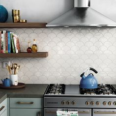 white tile mirror with fish scale tiles in modern kitchen - White Kitchen Remodel Kitchen Fan, Kitchen Backsplash, Kitchen Decor, Kitchen Design, Black Wall Tiles, White Tiles, Scallop Tiles, Mermaid Tile, Fish Scale Tile