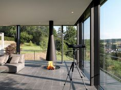 Modern Gas Fireplace Gallery - European Home Foyers, Contemporary Gas Fireplace, Fireplace Gallery, Houses In Germany, Mounted Fireplace, Open Family Room, Natural Stone Flooring, European House, Herd