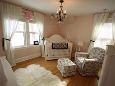 Girl: French Traditional  Muted pink walls paired with touches of black toile make this nursery room a classic. A sheepskin rug adds a cuddly touch. 'We wanted a nursery that was 'girly' and would fit with the character of our 1926 h