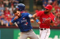 PEOPLE TRYING TO EXPLAIN THEIR POINT OF VIEW TO OTHER PEOPLE - Rangers second baseman Rougned Odor punches the Blue Jays' Jose Bautista
