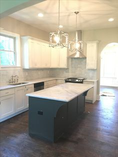 White Perimeter Kitchen Cabinets Gray Island. Sherwin Williams Snowbound  Sw7004. Marble Backsplash//