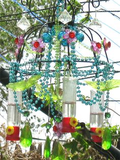 My DIY Chandelier Hummingbird feeder. I made it from 2 wire plant hangers. They love it!