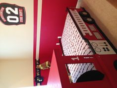 like the idea of the ladder on the wall to hand things on and love the shield as well