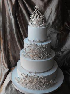 white curlicue wedding cake
