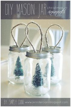 Simply Ciani: DIY Mason Jar Ornaments - take baby food jars, spray paint lids, add holes for twine, then glue in a small bottle brush tree & add some fake snow! by anne Mason Jar Christmas Crafts, Noel Christmas, Mason Jar Crafts, Mason Jar Diy, Diy Christmas Ornaments, Christmas Projects, Holiday Crafts, Christmas Decorations, Rustic Christmas